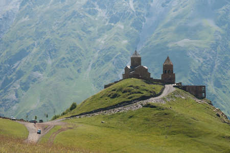 The Gergeti Trinity Church is the main cultural landmark of Kazbegi District, Georgia  The monastery is a popular waypoint for trekkers in the area Stock Photo - 16017641
