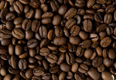 There are many coffee bean on the photo The relief of coffe bean surfaces is seen well  Stock Photo - 16160586