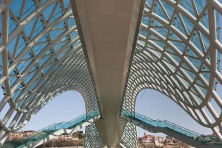 This is an example of levitating modern architecture. The Bridge of Peace is a bow-shaped pedestrian bridge over the Kura River in Tbilisi, capital of Georgia.