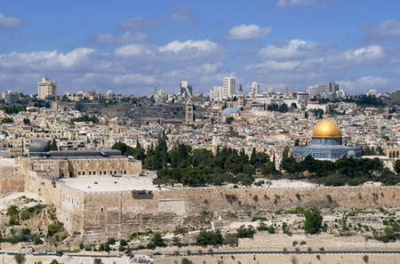 This is panorama of Jerusalem city. Photo contains ancient building, domes and modern architecture on the background. photo