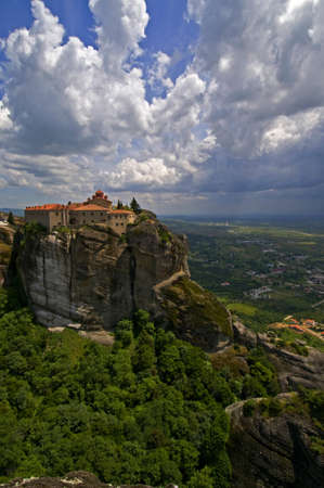 The Holy Monastery of St. Stephen is one of Meteora rock pillars in Greece. This is good combination of ancient architecture and rich landscape. photo