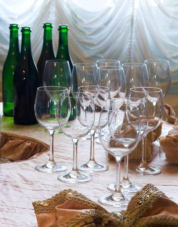 Wine glasses are in the foreground, bottles are in the background  It Stock Photo - 16273425