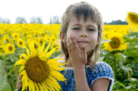 daubed: The girl has smelled a sunflower and  daubed herself with farina  She is situated on the field of sunflowers