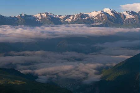 mestia: Morning  clouds separate into layers  This is Caucasus mountains, Georgia, Mestia   Stock Photo