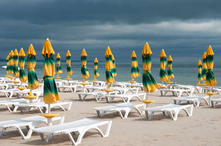 yellow umbrella: This is the back-end on the beach   Sunshades has been closed  Stock Photo