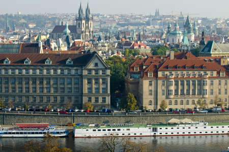 This is a general view of Prague, Czech Republic  Holiday cruisers and Vltava river are in the foreground