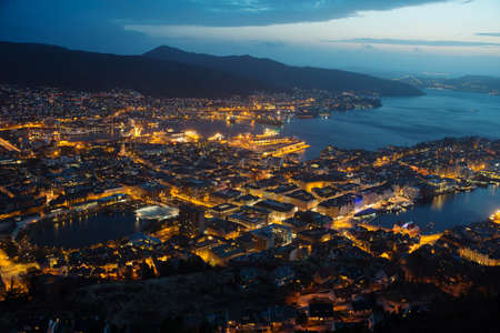 This is a top view of Bergen (the west coast of Norway) in night. The town is illuminated. photo