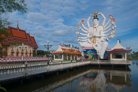 This is the statue of shiva on Samui island in Thailand. The buddhist temple is situated among the lake. photo