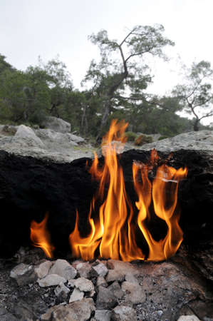 Flaming rock (Yanartas ) ) is generally believed to be the ancient Mount Chimera ( Antalya, Turkey). ).  The wonder-fires have been burning for at least 2500 years.  photo