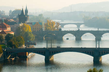 blotted: This is a general view of Prague in autumn. Famous bridges across Vltava river are blotted out by the fog.