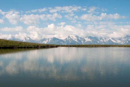 mestia: Clouds reflect in the mountain lake. This is Caucasus Mountains - Georgia, Mestia region, Qoruldi lake.
