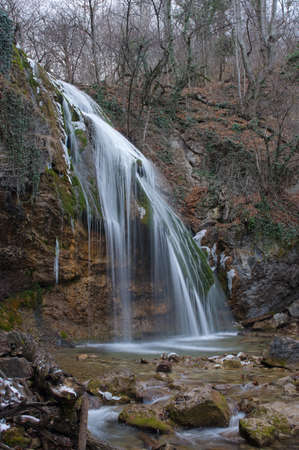 Such view waterfall Djur-djur has in winter. This is a famous waterfall of Crimea Mountains.