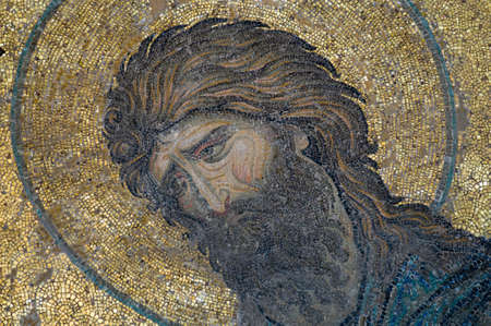 This image of John the Baptist, is the part  of mosaic from the Hagia Sophia (Istanbul, Turkey).  Emotional pain of holy men is seen well on this old  mosaic. Stock Photo