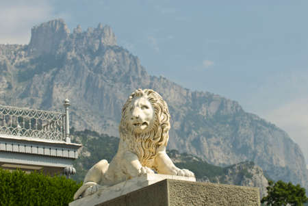 This marble lion sculpture is situated in Vorontsov Palace - Alupka, Crimea. The lion is situated against the famous Ay-Petry Mountains (Crimea).