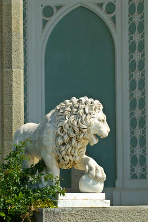 alupka: The marble lion sculpture is situated on the Southern veranda of Vorontsov palace (Alupka, Crimea). The animal sculpture is sunlit.