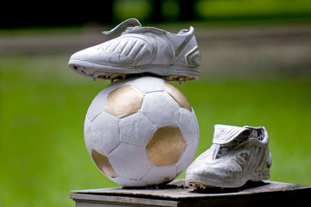 disputed: This interest monument of football is a part of iron-bound sculpture park (Donetsk, Ukraine, disputed territory). Stock Photo