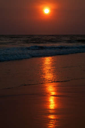 littoral: This is a beautiful sundown at the ocean coast. The sun is reflected on the littoral. Stock Photo