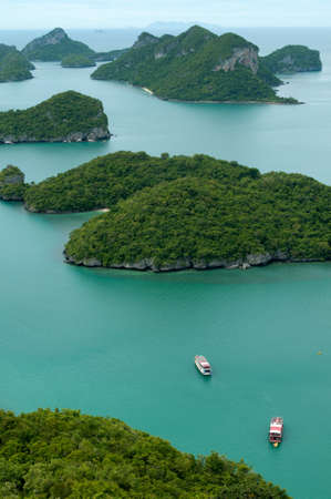 ang thong: Many green islands are scatter the sea. This is Archipelago of Ang Thong - National Marine Park near Koh Samui, Thailand. Stock Photo