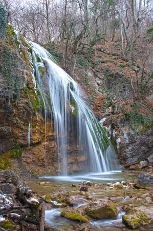 Such view waterfall Djur-djur has in winter. This is a famous waterfall of Crimea situated in the Mountains.