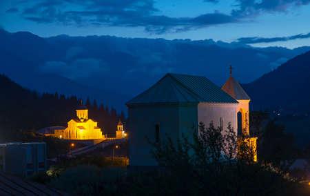 mestia: Night view of Mestia churches Georgia, Svaneti. Mountains and clouds are in the background. Stock Photo