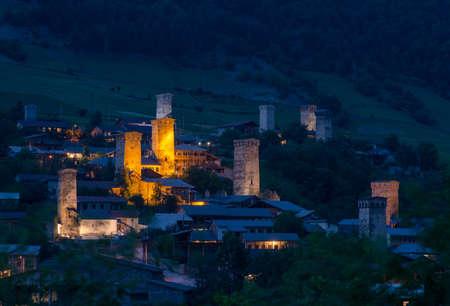 svan: Mestia highland townlet, Georgia - traditional svan towers are illuminated in evening.