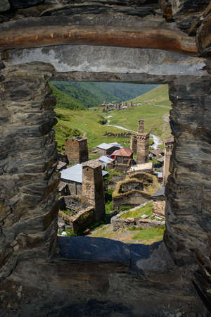 ushguli: Ushguli village view through a tower window. Ushguli is a community of villages located at the head of the Enguri gorge in Upper Svaneti, Georgia Caucasus Mountains. Altitude is 2,410 metres 7,910 ft.