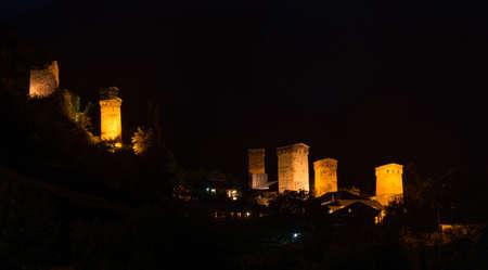 mestia: Tradition svanetian towers illuminated in night. Mestia Svaneti, Georgia. Stock Photo