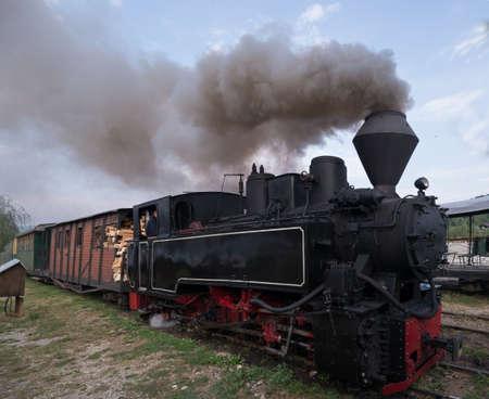 woodburning: Running wood-burning locomotive of Mocanita Maramures, Romania. Close-up. Editorial