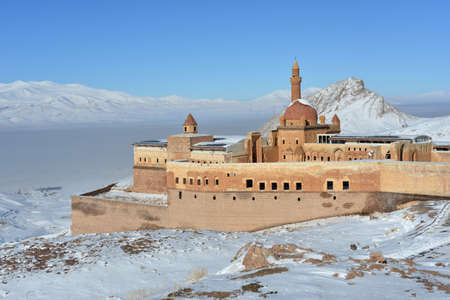 agri: Ishak Pasha castle against white mountains and blue sky background. The Ishak Pasha palace is located in the Dogubeyazit district of Agri province Eastern Turkey. Editorial