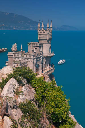 alupka: The Swallows Nest is a decorative building located in Gaspra: between Yalta and Alupka on the Crimean peninsula.  Neo-Gothic palace is situated against the seascape background.