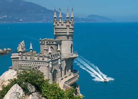The Swallows Nest is a decorative castle located in Gaspra,  Crimean peninsula.  Neo-Gothic palace is situated against the blue sea.