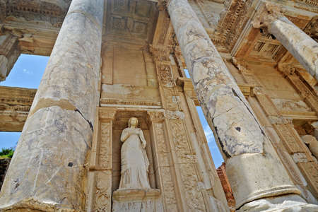by virtue: The library of Celsus is an ancient Roman building in Ephesus, Anatolia, now part of Turkey. These are details - sculpture of Arete, personification of virtue between two columns.