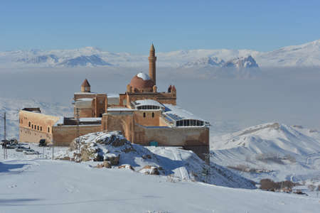 ottoman empire: Ishak Pasha Palace, the unique palace structure of Ottoman Empire that can reach this day in Anatolia. The palace is surrounded with high snow covered mountains. Editorial