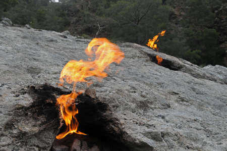 chimera: Attraction for tourist in Turkey - Flaming rock Yanartas is generally believed to be the ancient Mount Chimera Antalya, Turkey.