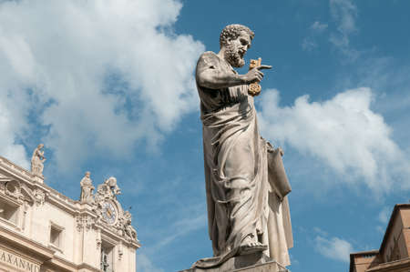 Sculpture of Saint Peter near St. Peters Basilica Vatican City. Blue sky end clouds are in the background.