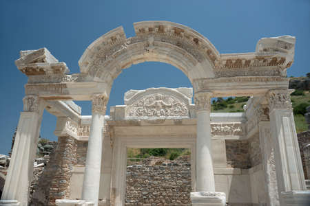 Highly decorated marble white temple against blue sky background. Ruins of ancient Greek and Roman city Ephesus now - Turkey.