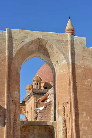 agri: Part of Ishak Pasha Palace against blue sky background. Stone decorations are seen. Stock Photo