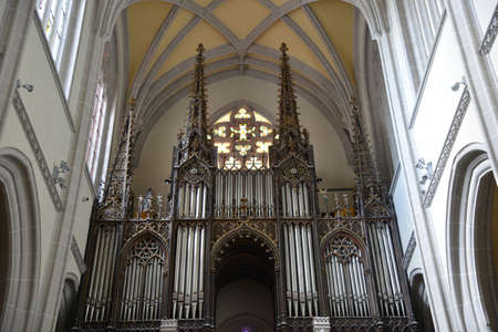 pipe organ: Pipe organ in Saint Elisabeth Cathedral (Kosice, Slovakia). Multicoloured  stained-glass window in background. Editorial