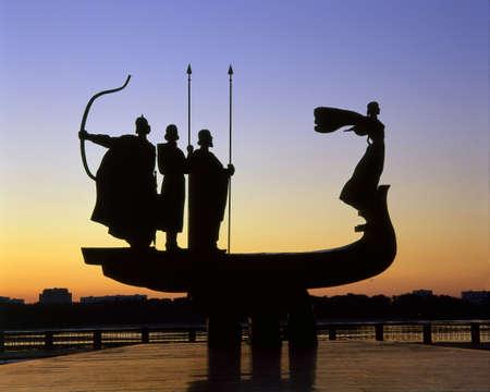 founders: Founders of Kiev monument silhouette against sunrise scene. Stock Photo