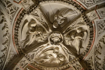 keystone: Baptistery ceiling decorated with angels sculpture in Cathedral of Saint James (Sibenik, Croatia). Stock Photo