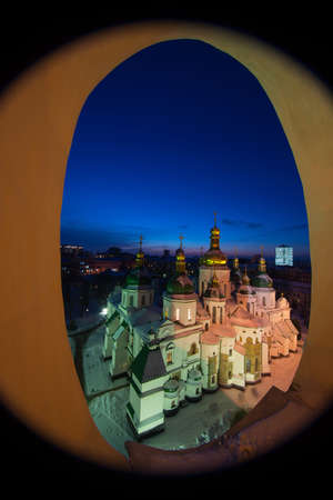Evening view of Saint Sophias Cathedral through  elliptical window. Ukraine, Kiev. Winter season.