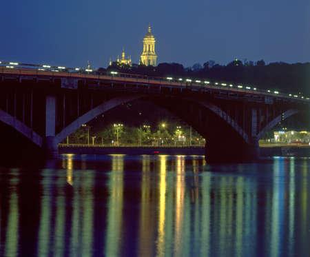 lavra: Kiev. Illuminated Metro Bridge and Kiev Pechersk Lavra at evening time.