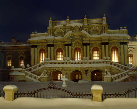 Illuminated Mariyinsky Palace (Kiev). Building is powdered with snow. Editorial