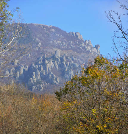 Autumn view of Ghosts Valley (Demerji) in Crimea. Rocks are situated against the blue sky background. Stock Photo