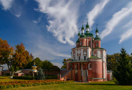 Sts. Peter and Paul Church of Trinity Monastery against blue sky background. Place - Gustin village, Ukraine.