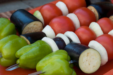 spat: Vegetables (tomato, eggplant, onion and paprika) are spat for grill cooking. Stock Photo