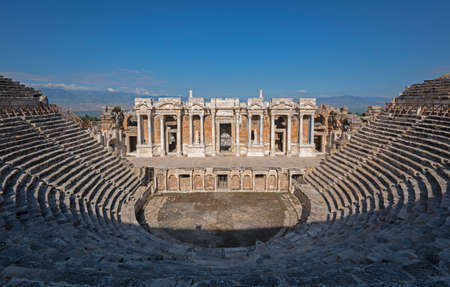 Ancient theatre in Hierapolis, Pamukkale (Turkey) top vie. Blue sky in background. Stock Photo - 81588166