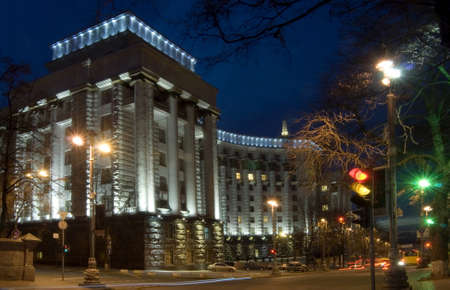 Illuminated council of ministers - Kiev, Ukraine. Dark blue sky in background. Stock Photo