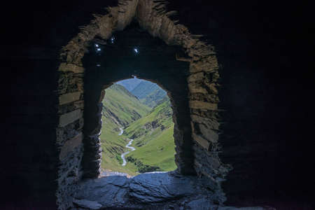 Beautiful landscape through the fortress window. Image contains space for text. Location - Tusheti region of Georgia. Dartlo tower.