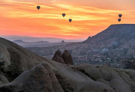 Hot-air balloons against sunrise scene. Cappadocia Редакционное